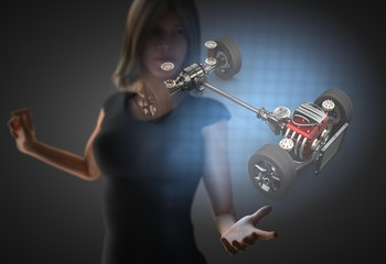 woman and hologram with car chassis