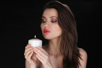 Portrait of a woman with a candle.