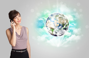 Young woman with earth and cloud concept