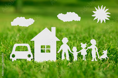 Paper cut of family with house and car on green grass - 81092024
