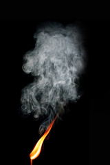 Burning matchstick with smoke
