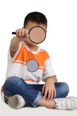 Boy holding a magnifying glass