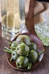Green olives on spoon