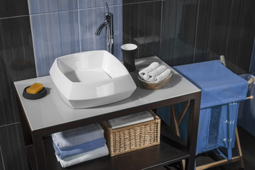 detail of a modern bathroom with sink and accessories_03
