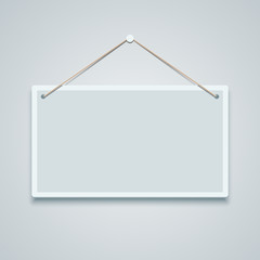 Blank sign board hanging on the wall.