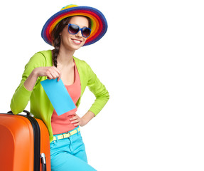 portrait of female tourist with travel suitcase and boarding pas