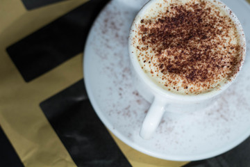 A cappuccino cup with cacao