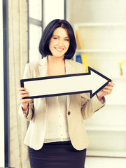 businesswoman with direction arrow sign