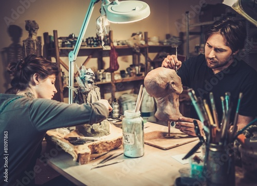 People working in a prosthetic special fx workshop - 81097863