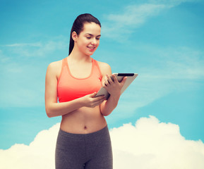 sporty woman with tablet pc computer