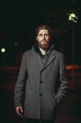 The guy with the beard coat goes on night street