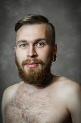 man with hair styling Razor Fade looking at the camera