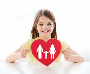 smiling little girl with red heart and family