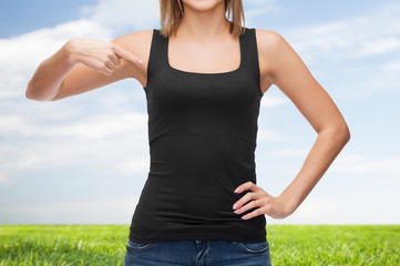 close up of woman in blank black tank top