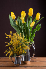 Two spring yellow bouquet of flowers