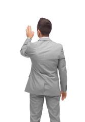 businessman touching something imaginary