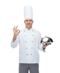 happy male chef cook with cloche showing ok sign