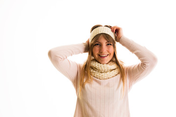 Girl in a sweater  smiling on a white background