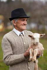 Old man with baby goat
