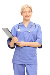 Female doctor in a blue uniform holding a clipboard