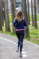 sporty woman running in the park