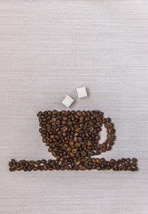 Coffee beans in a cup and sugar