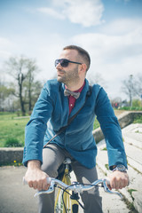 Young hipster man with a bike