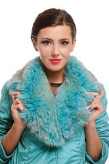 Beautiful girl in warm fur coat with fur