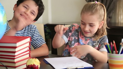 Elementary students doing homework together