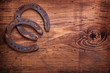 two horseshoe on vintage wooden board close up happy concept