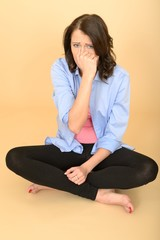 Young Crazy Woman Sitting on the Floor Wearing a Blue Shirt