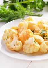 Baked cauliflower on white plate