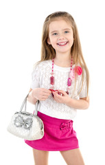 Cute smiling little girl in skirt wiht bag and beads