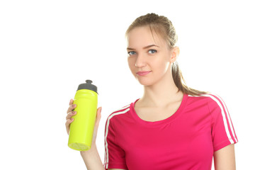 Girl in a tracksuit with a water bottle in hand isolated