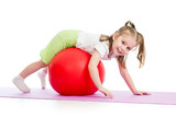 child girl doing fitness exercise with fitball