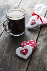 Gingerbread heart and coffee  on rustic wooden background