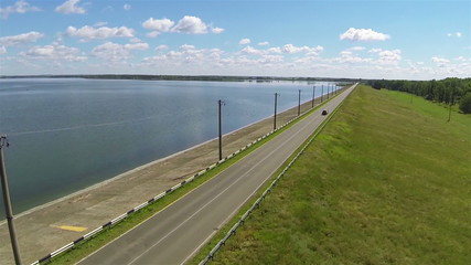 Beautiful road with car  and lake. Aerial shot