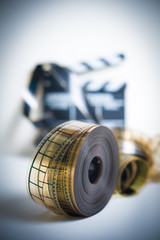 35mm movie reel with out of focus clapper in background, vertica