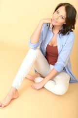 Relaxed Attractive Beautiful Young Woman Sitting on the Floor