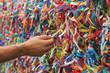 Hand Touching Colorful Bonfim Ribbons in Salvador, Bahia, Brazil - 81111489