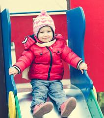 little girl riding a roller coaster