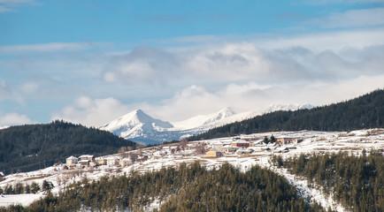 Distant Snowy Mountain Village