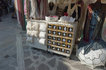 Traditional handmade lace for sale in Burano, Venice, Italy.