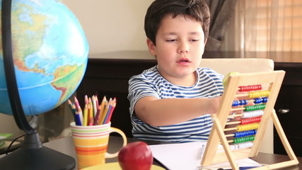 Little student using abacus