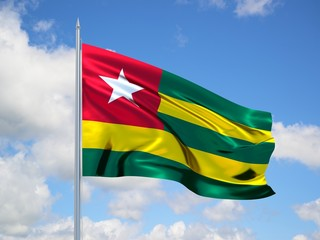 Togo 3d flag floating in the wind in blue sky