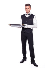 Young person in a suit holding an empty tray isolated on white