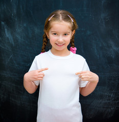 girl standing in a white T-shirt