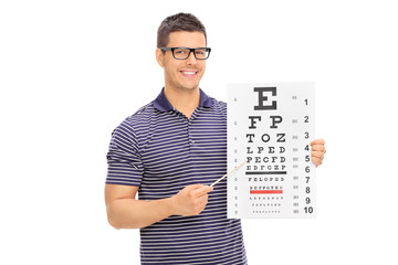 Young man with glasses holding an eyesight test