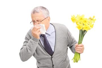 Senior having an allergic reaction to flowers