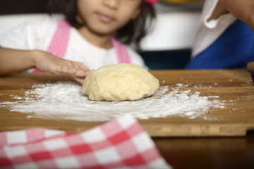 Little Girl Making Dough